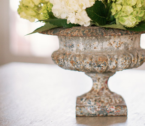 Vintage urn with flowers and a lovely antiqued patina